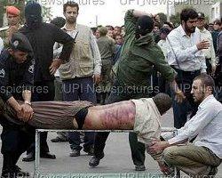داعشی ها یک زن ایرانی را شلاق زدند+عکس